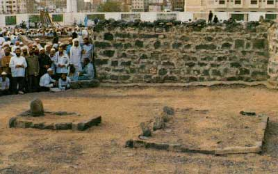 Qabr e Fatima(AS) at Baqi- The wall erected to bar shias from grave can be seen in background